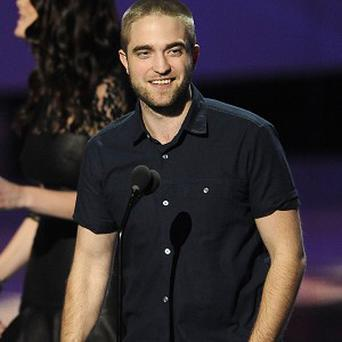Robert Pattinson showed off his new look when he accepted a People's Choice gong