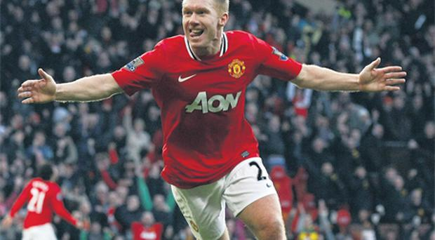 Manchester United's Paul Scholes celebrates scoring the 151st United goal of his career, his first since August 2010
