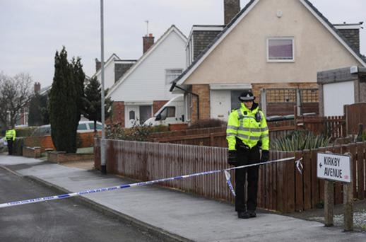 Police at the scene in Kirkby Avenue, Garforth, Leeds, where the bodies of a woman and child were discovered last night. Photo: PA