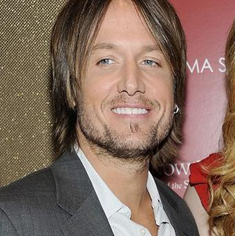 Country singer Keith Urban had surgery to remove a polyp from a vocal cord (AP)