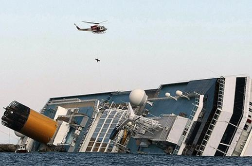 A helicopter evacuates Marrico Giempietroni, the Costa Concordia's cabin service director after he was rescued from the Costa Concordia. Photo: Getty Images