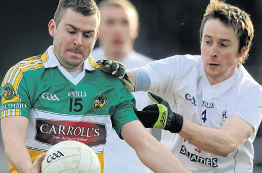 Ken Casey of Offaly is closed down by Kildare's Ollie Lyons at Newbridge yesterday