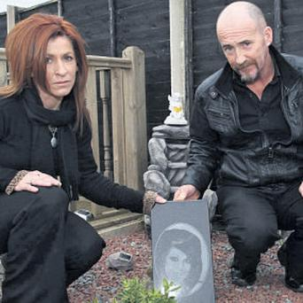 Rita Martin and Martin Doyle at a memorial in their home to their daughter Lena