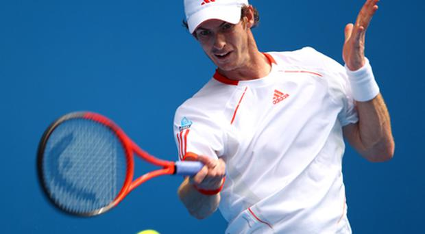 Andy Murray plays a forehand in his first round match against Ryan Harrison. Photo: Getty Images