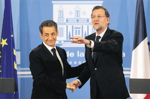 French president Nicolas Sarkozy is greeted by Spanish prime minister Mariano Rajoy as the leaders held talks in Madrid yesterday on the continuing euro crisis