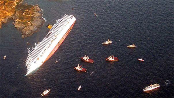 The costa Concordia surrounded by rescue vessels off the Tuscan coast