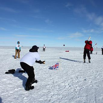 Britain triumphed over the rest of the world in a game of 'extreme' cricket at the South Pole