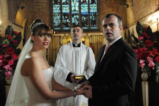 Archive photo by ITV of the wedding of Steve McDonald and Tracy Barlow which was interrupted by Becky McDonald in a heart-stopping moment which brings Coronation StreetâÄôs love triangle to a tense climax.
