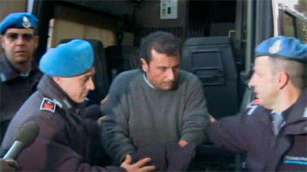 Francesco Schettino is escorted to prison by police. Photo: Reuters