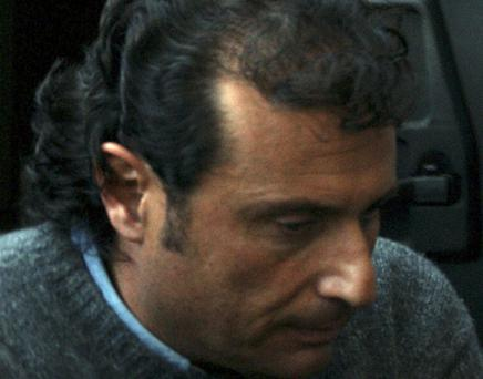 Francesco Schettino, the captain of the Costa Concordia cruise ship that run aground the tiny Island of Giglio last Friday, leaves the Grosseto court, Italy, Tuesday, Jan. 17, 2012. Prosecutors have accused Capt. Francesco Schettino of manslaughter, causing a shipwreck and abandoning his ship before all passengers were evacuated during the grounding of the Costa Concordia cruise ship Friday night. Five more bodies were pulled Tuesday from the crippled cruise ship off Tuscany, and a shocking audio emerged in which the ship's captain was heard making excuses as the Italian coast guard repeatedly ordered him to return on board to oversee the ship's evacuation. (AP Photo/Alessandro La Rocca, Lapresse) ITALY OUT