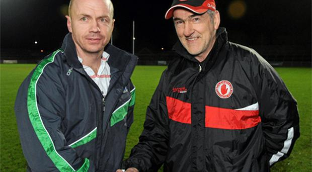 Fermanagh manager Peter Canavan shakes hands with his mentor, Tyrone boss Mickey Harte, before the start of last night's Dr McKenna Cup clash. Photo: Sportsfile