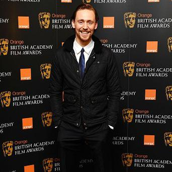 Tom Hiddleston is enjoying watching co-star Benedict Cumberbatch's success