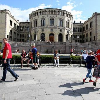 The head of Norway's secret service is resigning after she disclosed too much information in Oslo's parliament