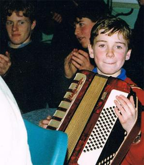 A young Michael Fassbender playing the accordion in Fossa Youth Club, Co Kerry in 1989
