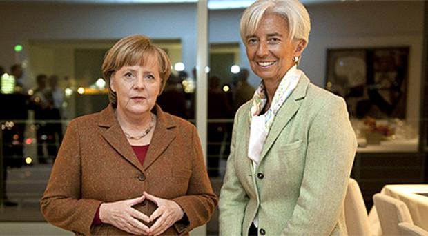 German Chancellor Angela Merkel and Christine Lagarde, Managing Director of the IMF