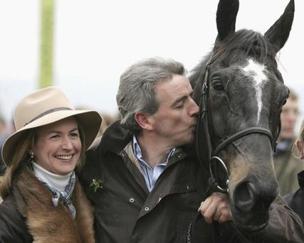 CHELTENHAM, UNITED KINGDOM - MARCH 17: Owner Michael O'Leary and his wife pose with War of Attrition after they win The Totesport Gold Cup Steeple Chase during the Cheltenham Festival Day 4 at Cheltenham Race Course on March 17, 2006 in Cheltenham, England. (Photo by Christopher Lee/Getty Images)