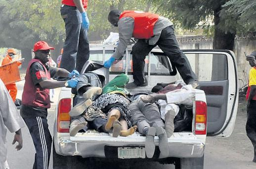 TERROR: Some victims' bodies are collected in Kano on Friday
