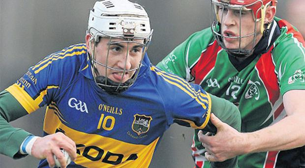 Tipperary's Patrick Maher tries to get away from Colin Madden of Limerick IT