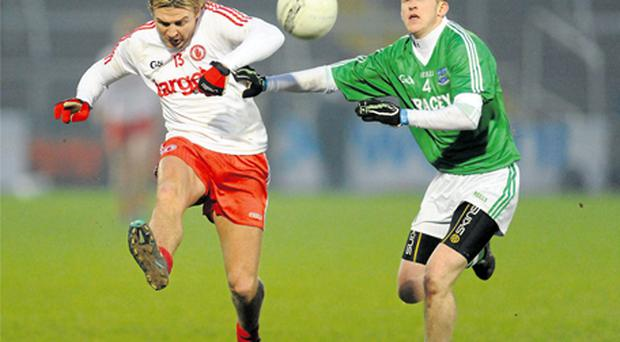 Tyrone's Owen Mulligan in action against Fermanagh's John Woods during their Dr McKenna Cup semi-final at the Morgan Athletic Grounds