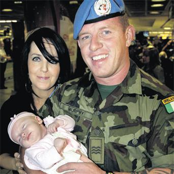 Back safe and sound: Sgt Lloyd Murphy is greeted by his wife Winnie and daughter Molly at Dublin Airport on his return from Lebanon. If your partner is heading off with the Defence Forces make sure you get all the support you can in their absence