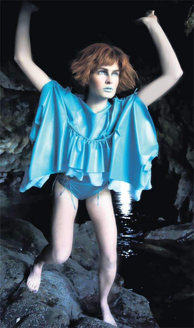Model Vanessa Jobb poses in a turquoise dress, designed by NCAD graduate Anne Carey