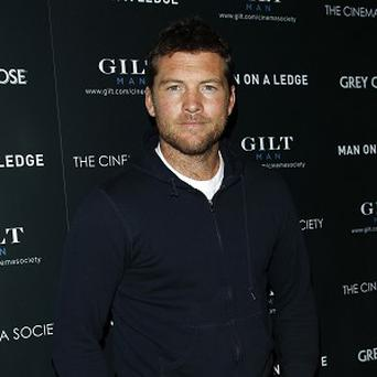 Sam Worthington says he's a pussycat in real life