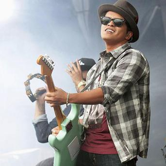 Bruno Mars was top of the download charts last year