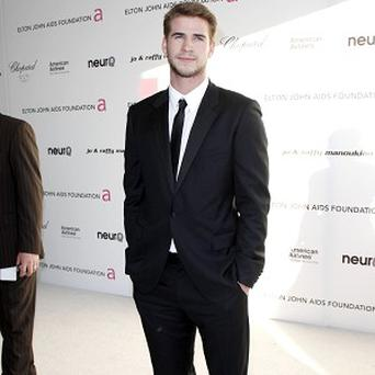 Liam Hemsworth will play a would-be time traveller in his latest movie role