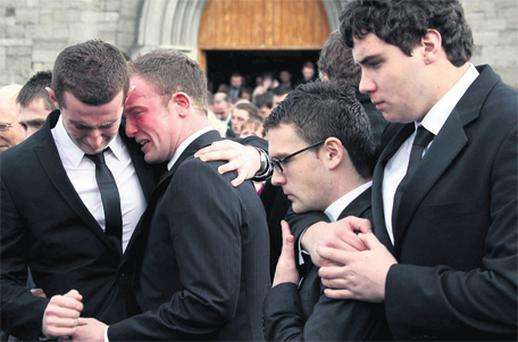 Friends at the funeral of Ciaran Carr yesterday morning in Clondalkin, Dublin