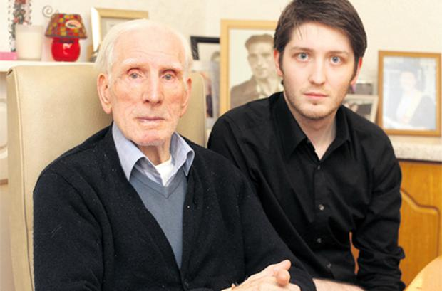 Patrick Martin with his grandfather Phillip Farrington who fought in World War Two and was then branded a deserter by the Irish Defence Forces