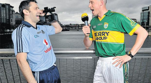 Dublin's Alan Brogan and Kerry's Kieran Donaghy get into the swing of things at the launch of Setanta Sports Allianz National Leagues coverage in Dublin yesterday. The NFL kicks off with Dublin v Kerry on February 4
