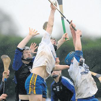 Ciaran Quirke of Thurles CBS wins the ball ahead of his team-mate Sean Maher (right) and Nenagh's Conor Leo (left)