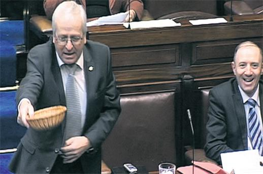 Independent TD Mattie McGrath getting out his basket for donations in the Dail yesterday