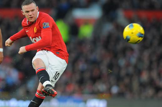 Wayne Rooney sustained knocks to his calf and ankle in Sunday's win at Arsenal. Photo: Getty Images