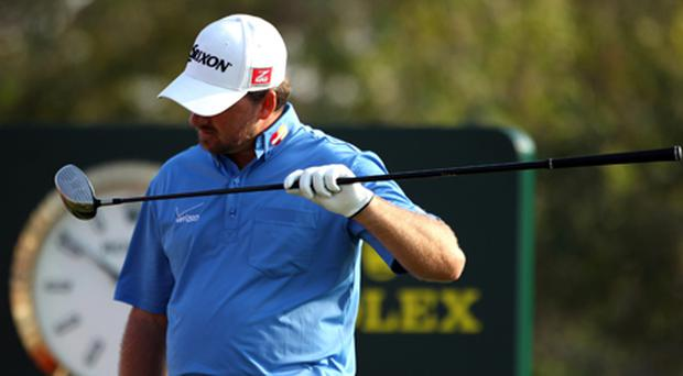 Graeme McDowell inspects his driver for damage. Photo: Getty Images