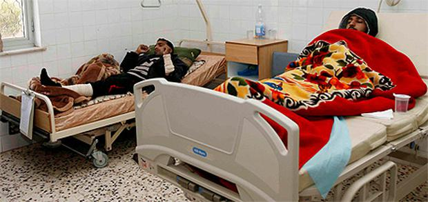 Two injured men from Assabia who say they were tortured lie in hospital in Tripoli