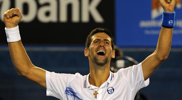 Novak Djokovic celebrates after victory over Andy Murray. Photo: Getty Images