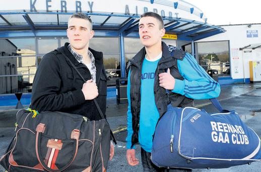 John Curran, from Valentia, and Kevin Moran, from Reenard, Co Kerry, at the airport yesterday before they departed for London to look for work. John is the 14th member of his football team, The Young Islanders, to emigrate.
