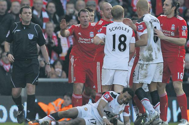 Manchester United's Nani lies on the ground following a challenge by Jamie Carragher of Liverpool during the Premier League game at Anfield last March