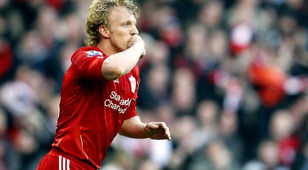Liverpool's Dirk Kuyt celebrates after scoring their second goal of the game
