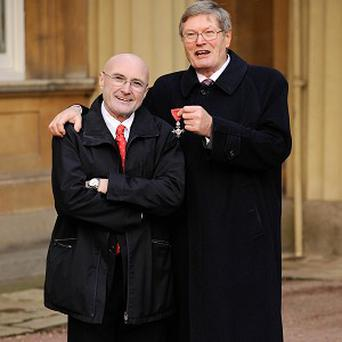 Phil Collins watched his brother Clive Collins receive an MBE from Prince Charles