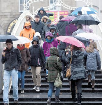 Members of the public braving the wet weather in Dublin city yesterday