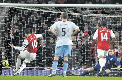 Robin van Persie sends Shay Given the wrong way to score the first of his two penalties in Arsenal's victory yesterday