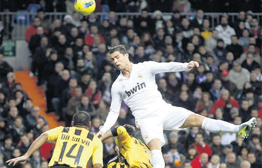 Real Madrid's Cristiano Ronaldo fights to head the ball with Real Zaragoza's Paulo Cesar Da Silva during their La Liga match