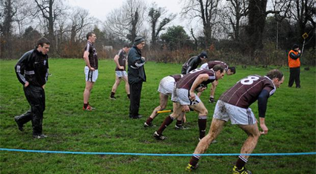 Galway hurling manager Anthony Cunningham puts his players through some sprints after their match at Belfield. Photo: Sportsfile
