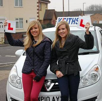 Rosie and Lucy Carleton, 17, who passed their driving tests at exactly the same time