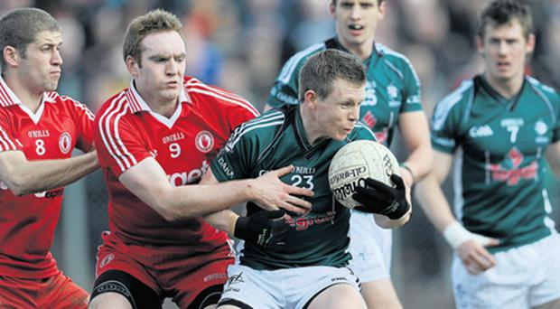 Kildare and Tyrone, seen here in last year's league meeting, are again favourites for promotion from Division Two