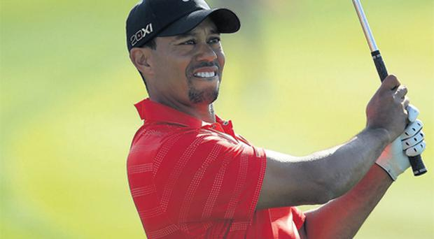 Tiger Woods failed to unnerve Robert Rock in the final round in Abu Dhabi