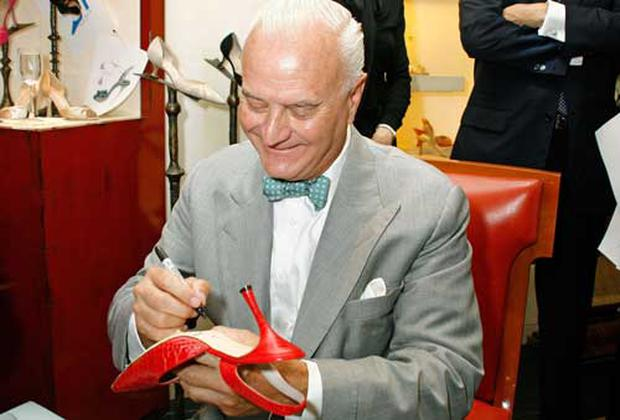 Shoe designer Manolo Blahnik signs a shoes as he makes a personal appearance at Bergdorf Goodman in New York Photo: Getty Images