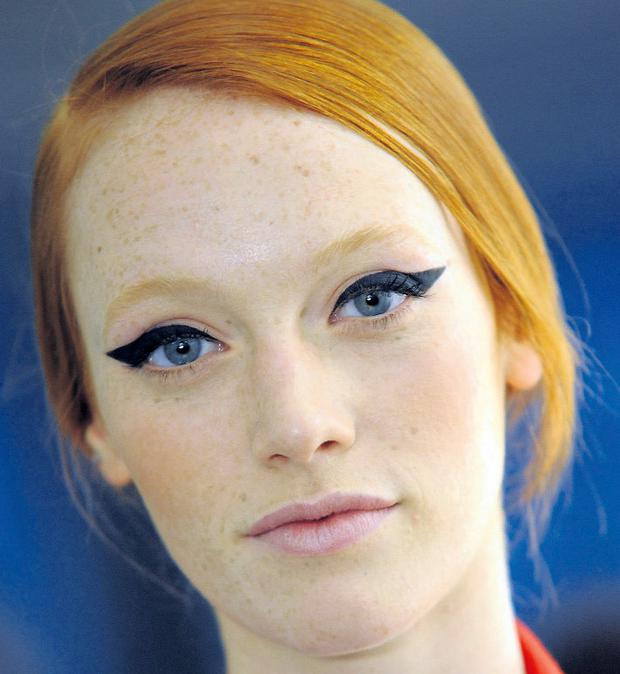 Use a waxy pencil to draw the line you want before applying liquid eyeliner for best results